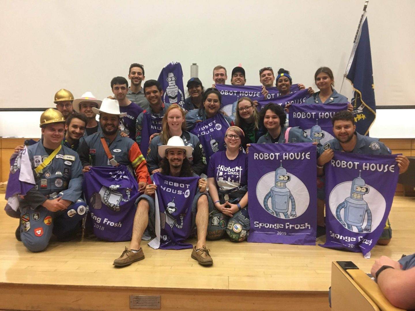 Frosh leaders holding purple banners that read Robot House